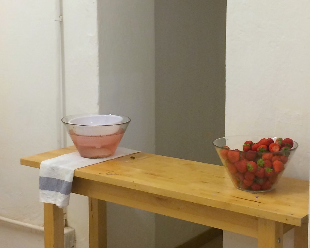 Fifty-eight pints of strawberries await baptism in water.