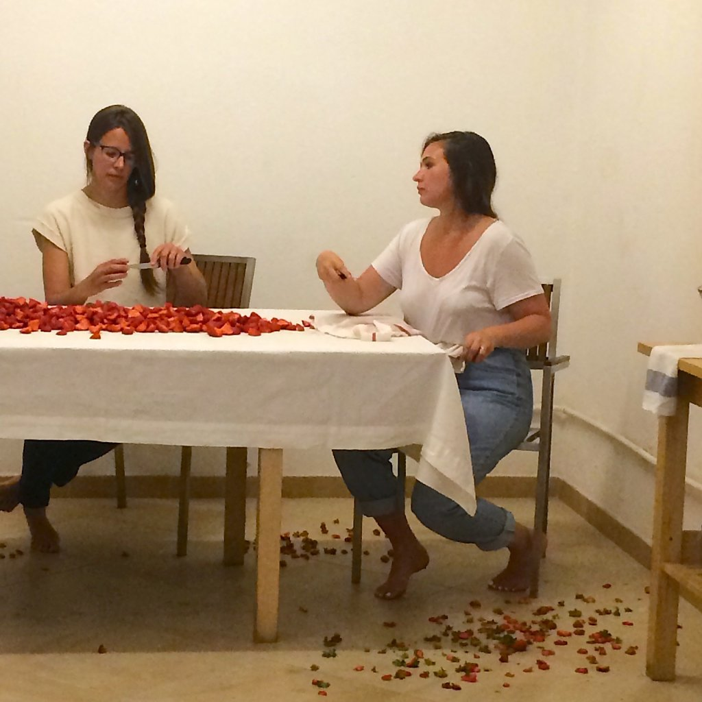 The cleaned and prepared strawberries spread across the table.